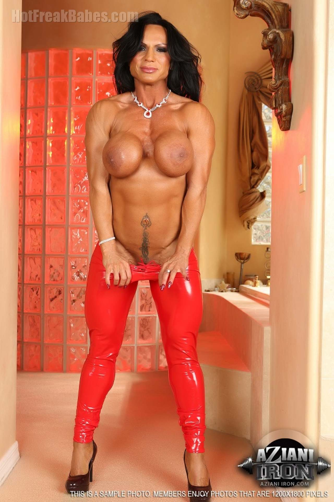 Rhonda Lee, latex, red latex, busty, mature, big tits, fake tits, Aziani Iron, FBB, female bodybuilders, fitness models, muscle posing photos and videos